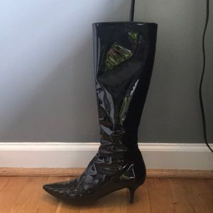 Valentino to knee patent leather heeled boots.